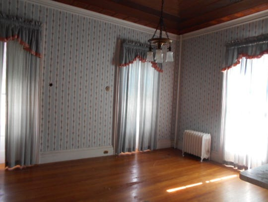 Original inlaid hardwood floors and ceilings remain