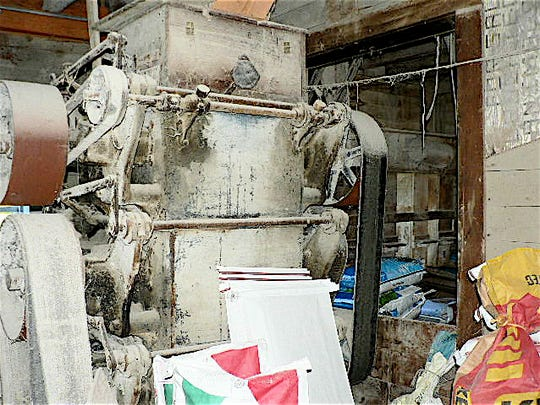 The once much used roller mill now stands silent.