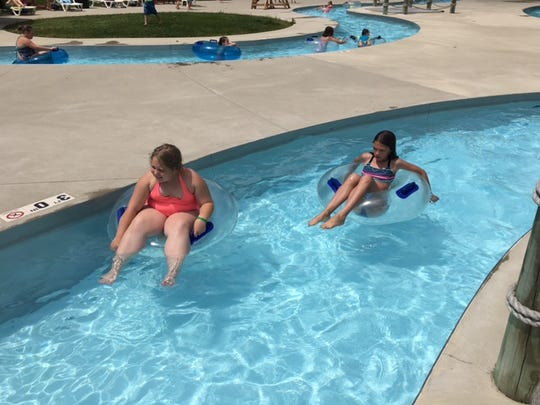 Two girls enjoy the lazy river at Lincoln Park Marion Aquatic Center Tuesday afternoon as temperatures reached 90 degrees.