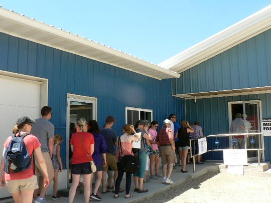 Lining up to see the milking parlor.