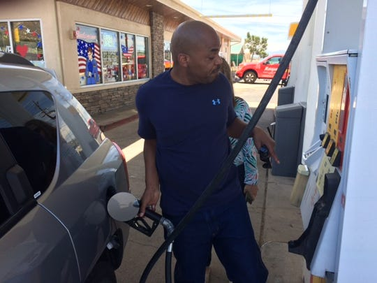Ha'im Al Matin Sharif pumps gas on his way to Phoenix