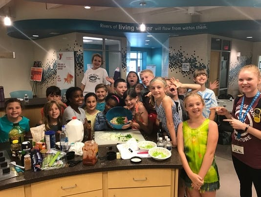 636332212874645420-YMCA-cooking-camp-group-pic.jpg