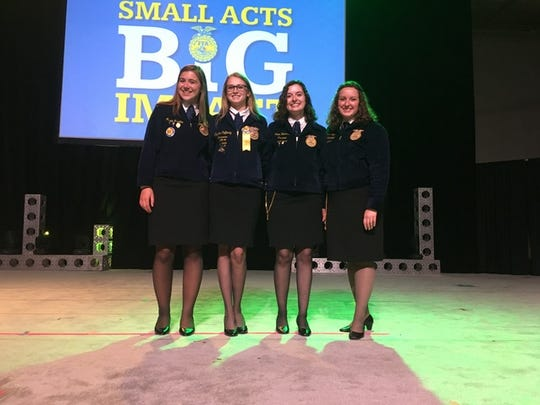 Alexis Luedtke, Beaver Dam; Crystal Cafferty, Mauston; and Colleen Toberman, Parkview have been selected to join the state officer team representing Wisconsin as voting delegates at the National FFA Convention. Joining them on stage is WI FFA President Brenna Bay (right).