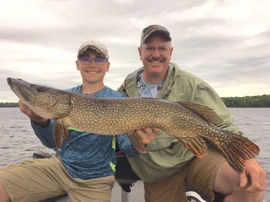 Wyatt Evans, left, and his dad Scott