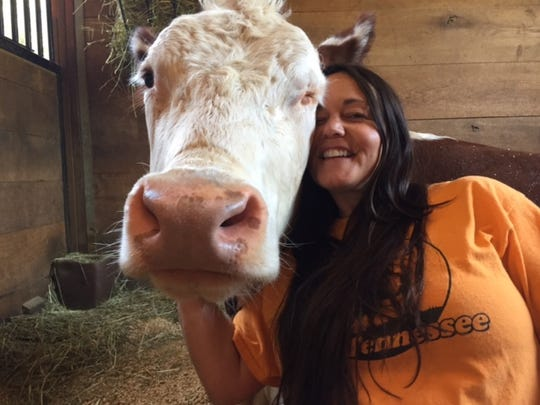 Gentle Barn founder Ellie Laks shares a hug with Dudley.