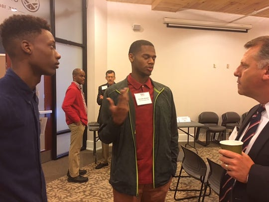 Dominic Holland, left, student at Fulton High School, and Kwanbe Bullard, middle, student at Austin East High School, talk with Tim Romero, East Tennessee regional vice president of Enterprise Holdings at the Knoxville Chamber's Diversity Champions CEO Summit.
