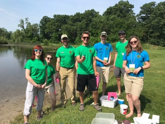 Group leaders for the Stepping Stones program prepare to gather water samples at Proud Lake State Recreation Area. This is the second summer working with the program for Sarah Dickson, far left.