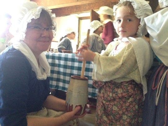 Programs include candle making, tin punch designs, butter making and learning an English country dance.