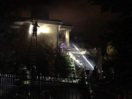 Four people were displaced after a home caught on fire