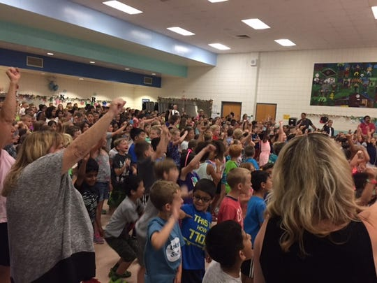 Students and staff at Thornton Creek Elementary react,