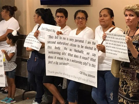 Immigrants and advocates of the Tennessee Immigrant and Refugee Rights Coalition hold signs Thursday, July 6, 2017, protesting the Metro Council's withdrawal of legislation that would have limited Metro's cooperation with federal immigration law.