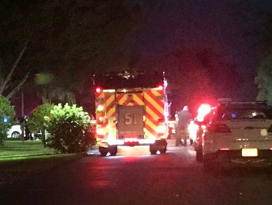 An emergency vehicle is stationed in a San Carlos Park