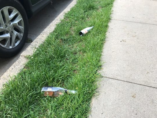 Bottles littered the ground near the scene of a fatal shooting Sunday night in Mount Vernon.