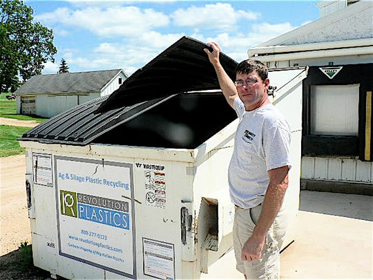 Troy Statz, of Statz Brothers Dairy, Marshall and one of several dumpsters on the family dairy.