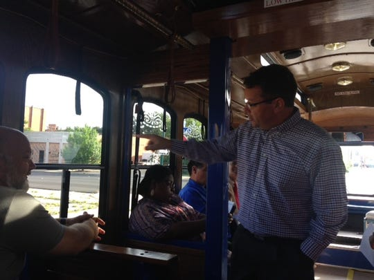Danny Ahearn talks Thursday during a trolley tour of downtown about a former gas station that he hopes to refurnish and turn into a restaurant or business.