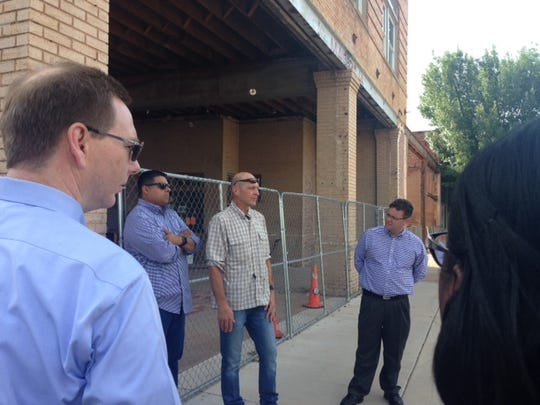 In this file photo, Will Tucker, center, talks with the Downtown Steering Committee members about his work on the former Magnolia building across from the Farmers Market. Another real estate developer, Will Kelty, was recently approved by the 4B board and city council for up to $800,000 for a fire suppression system in the Petroleum Building at 726 Scott.