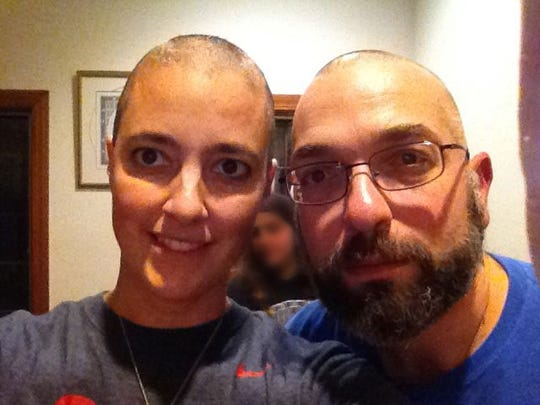 Dr. Amy Reed, left, pictured with her husband, Dr. and Hooman Noorchashm, at the start of her chemo treatment for a uterine cancer. Reed underwent a procedure called morcellation which upstaged her previously undiagnosed cancer. She died in May.