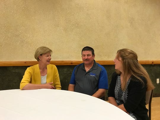 U.S. Sen. Tammy Baldwin (left) discusses a visit to the Tomah VA Medical Center with Marvin Simcakoski and his wife, Linda, in 2017.