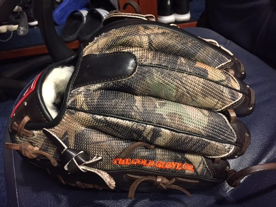 Brewers pitcher Josh Hader, who is a big outdoorsman, has a camouflage-style baseball glove.