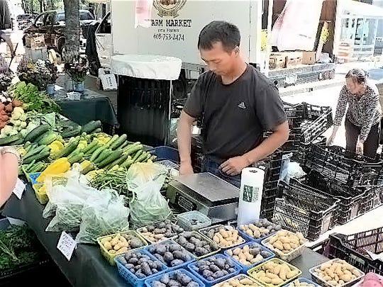 Originally from Laos, he farms 25 acres near Eau Claire