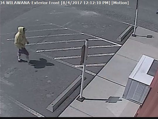 Security footage of an armed robbery incident that occurred at the Smokin' Joe's Tobacco Shop at 2853 Wilawana Road on Friday.
