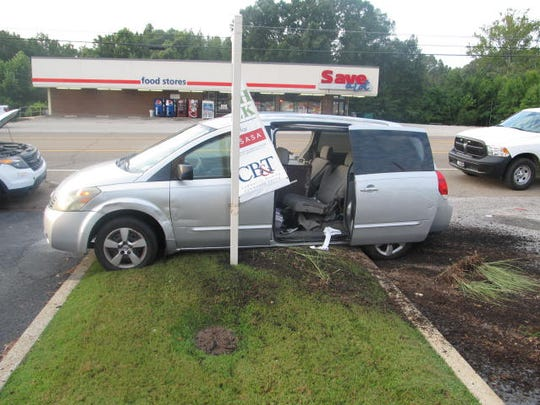 The suspects' van sits on East Main Street in Huntingdon after it was involved in a police chase Tuesday morning.