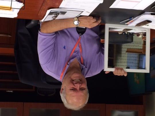 Geoffrey Gordon last summer at his office in Tenafly,
