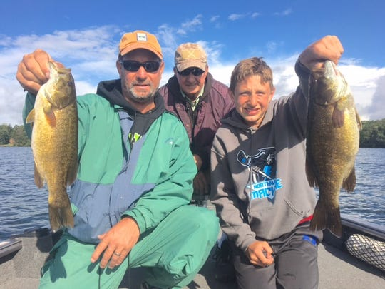 George, Dan, and Jeremy Hollow with a couple big smallmouth