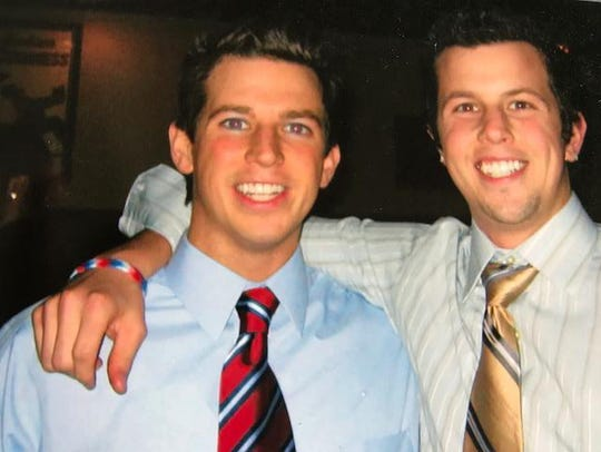 Nolan Webster (right) died at age 22 in the pool at