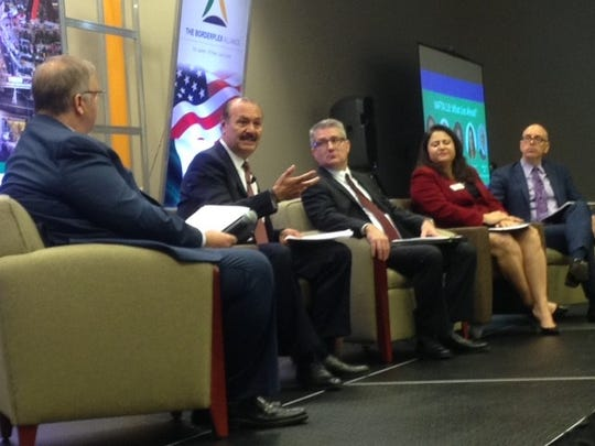 Marcos Bucio Mújica, consul general of Mexico in El Paso, explains the benefits of NAFTA during a panel discussion Wednesday at the first day of the U.S.-Mexico Border Summit in El Paso and Juarez.