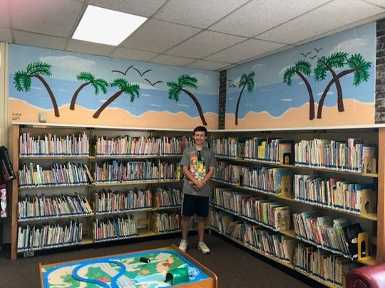 Michael Nowicki, 21, is an accomplished artist with autism and other medical disabilities. He spent the summer giving back to his community. Nowicki designed and painted a mural in the children's section of the Dunellen Library.