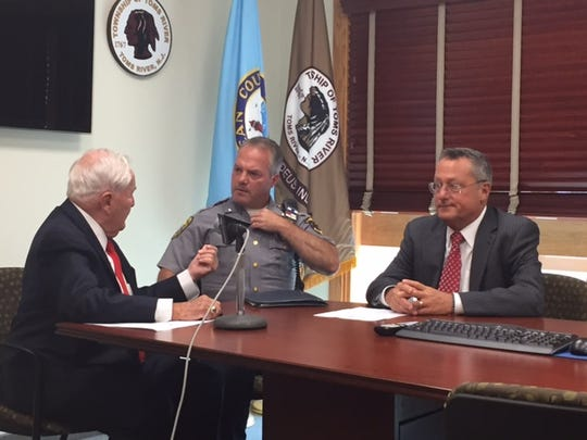 Toms River Mayor Thomas F. Kelaher (l) talks with Police
