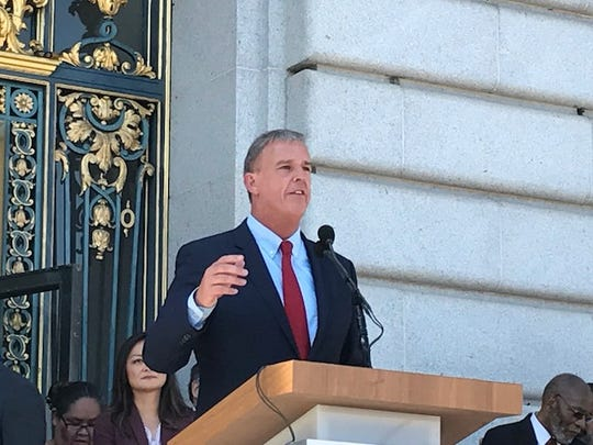 """San Francisco Supervisor Jeff Sheehy addressing a rally for """"San Francisco values of love and compassion"""" at City Hall."""