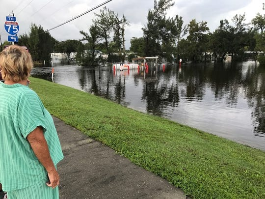 Sandy Wood, a resident at Wilder RV Resort off U.S. 41 near Alico Road looks over flooding in the part of the park where she lives. She was evacuated from the resort on Sunday.