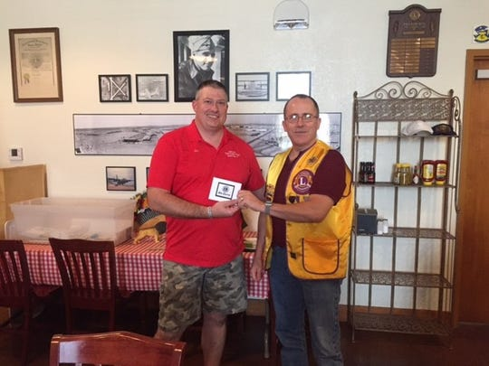 Jon Earley, president of the Chili Super Bowl board, meets with Abilene Founders Lions Club member David Batiz at the club's Aug. 17 meeting.