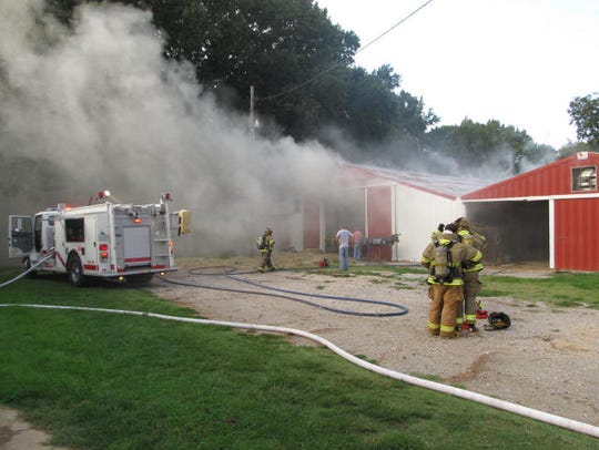 Hay in a Huntingdon barn caught fire Monday evening,