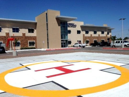 A helicopter pad is next to the parking lot at the
