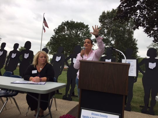 Andrea Boxill, deputy director of Ohio Mental Health and Addiction Services, speaks at Ottawa County's Overdose Awareness Day Thursday in Port Clinton.