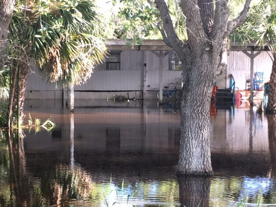 Flood waters engulf one of 48 units at the Saldivar migrant camp east of Bonita Grande Drive in Bonita Springs on Friday .