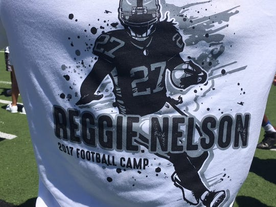 The official T-shirt at the Reggie Nelson Football