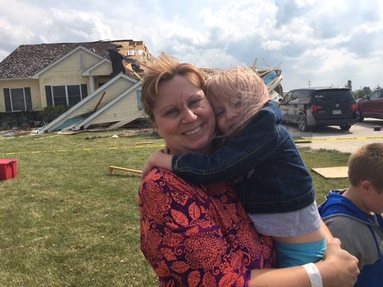 Susan Cooper and her daughter Alyse escaped injury after they were thrown from a bedroom into the backyard after Monday night's storm hit their house at 5511 Hook Road. ripping the roof off the bedroom.