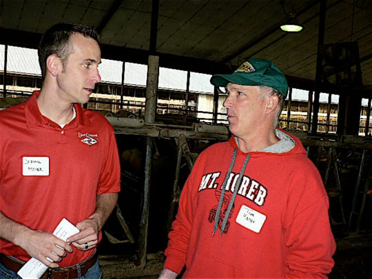 Jerome Meyer, East Central Breeders Manager (left) and Tim Keller, Mt. Horeb dairyman in deep discussion.