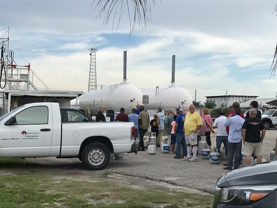 Customers wait in line for propane at Balgas at Katherine