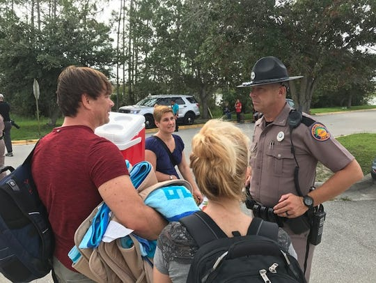 Florida Highway Patrol trooper Michael Lipari speaks