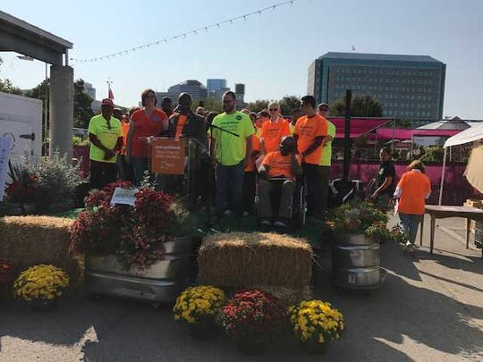 Members of the Transit for Nashville Coalition gather at the Nashville Farmers' Market on Saturday.