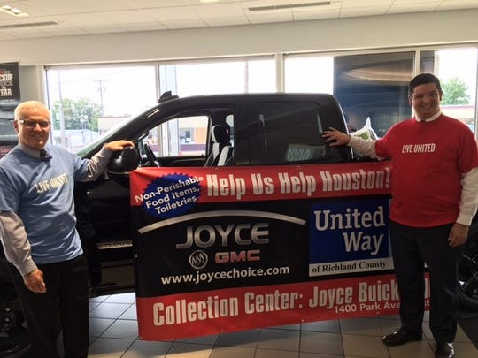 "A relief effort is under way at Joyce Buick GMC on Park Avenue West. ""Help Us Help Houston and now Florida"" will continue through Sept. 29 United Way of Richland County is partnering with United Way of Houston to bring needed items including non-perishable items and personal hygiene items. Brian Joyce, co-owner of the dealership, and Dan Varn, director of the local United Way agency, stand beside the truck."