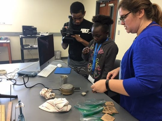 Participants work on a project at the Pathfinders Program sponsored by the Carver Community Organization. The program is free to students and focuses on STEM skills.
