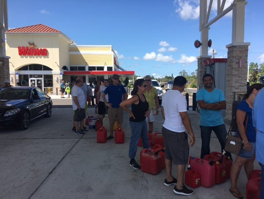 A line forms for people with gas cans at the Wawa in