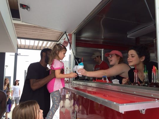 Old Tyme Grocery serves snow cones to evacuees.