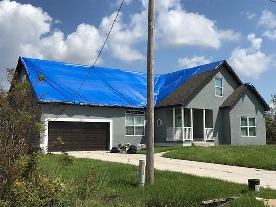 Blue-taped roofs dotted homes around Lehigh Acres in